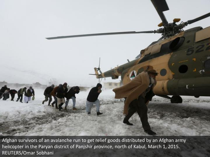 Afghan survivors of an avalanche run to get relief goods distributed by an Afghan army helicopter in the Paryan district of Panjshir province, north of Kabul, March 1, 2015. REUTERS/Omar Sobhani