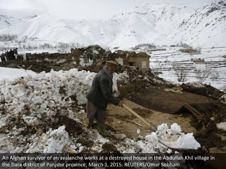 An Afghan survivor of an avalanche works at a destroyed house in the Abdullah Khil village in the Dara district of Panjshir province, March 1, 2015. REUTERS/Omar Sobhani