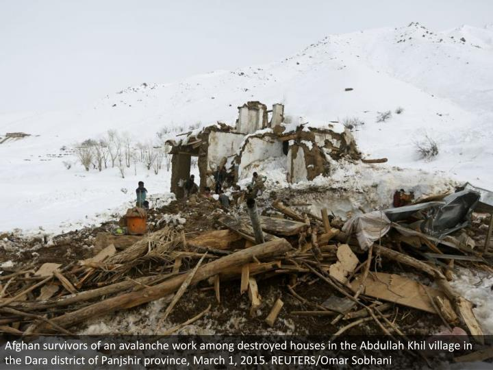 Afghan survivors of an avalanche work among destroyed houses in the Abdullah Khil village in the Dara district of Panjshir province, March 1, 2015. REUTERS/Omar Sobhani