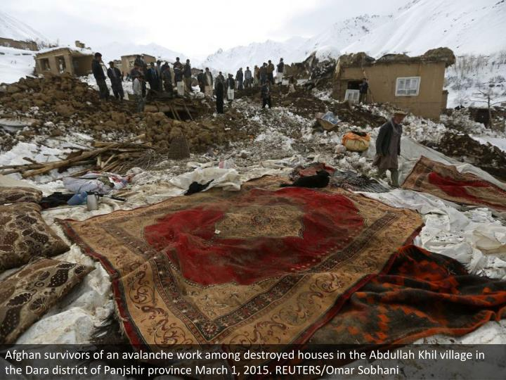 Afghan survivors of an avalanche work among destroyed houses in the Abdullah Khil village in the Dara district of Panjshir province March 1, 2015. REUTERS/Omar Sobhani