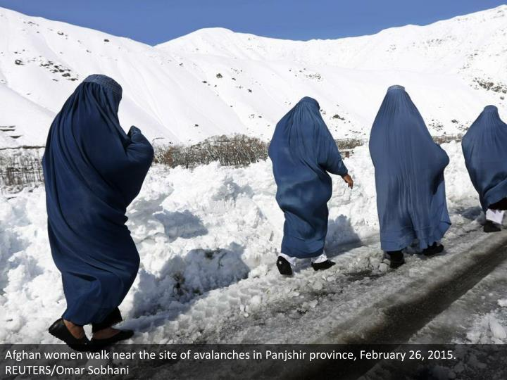 Afghan women walk near the site of avalanches in Panjshir province, February 26, 2015. REUTERS/Omar Sobhani