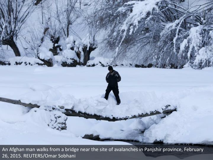 An Afghan man walks from a bridge near the site of avalanches in Panjshir province, February 26, 2015. REUTERS/Omar Sobhani