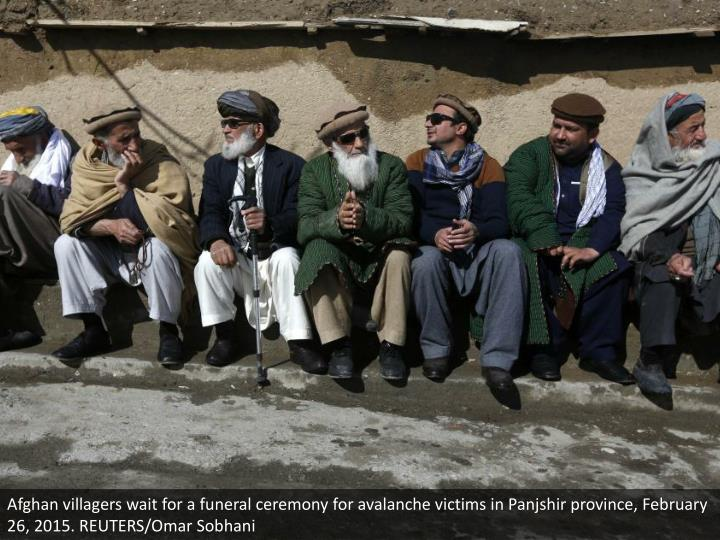 Afghan villagers wait for a funeral ceremony for avalanche victims in Panjshir province, February 26, 2015. REUTERS/Omar Sobhani