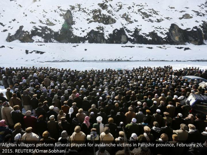Afghan villagers perform funeral prayers for avalanche victims in Panjshir province, February 26, 2015. REUTERS/Omar Sobhani