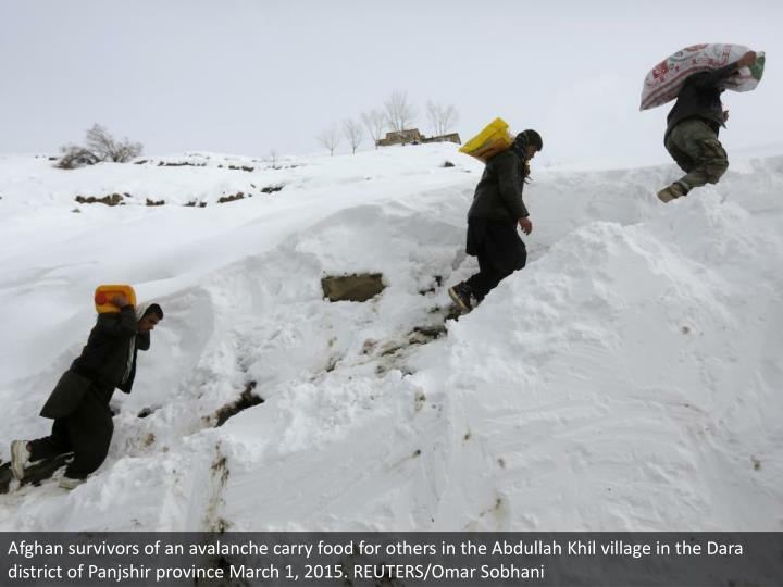 Afghan survivors of an avalanche carry food for others in the Abdullah Khil village in the Dara district of Panjshir province March 1, 2015. REUTERS/Omar Sobhani