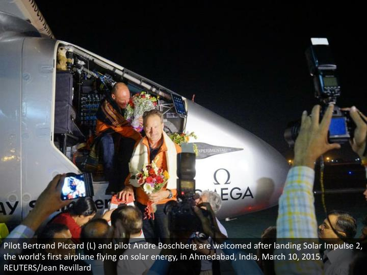 Pilot Bertrand Piccard (L) and pilot Andre Boschberg are welcomed after landing Solar Impulse 2, the world's first airplane flying on solar energy, in Ahmedabad, India, March 10, 2015. REUTERS/Jean Revillard