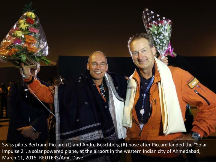 "Swiss pilots Bertrand Piccard (L) and Andre Boschberg (R) pose after Piccard landed the ""Solar Impulse 2"", a solar powered plane, at the airport in the western Indian city of Ahmedabad, March 11, 2015. REUTERS/Amit Dave"