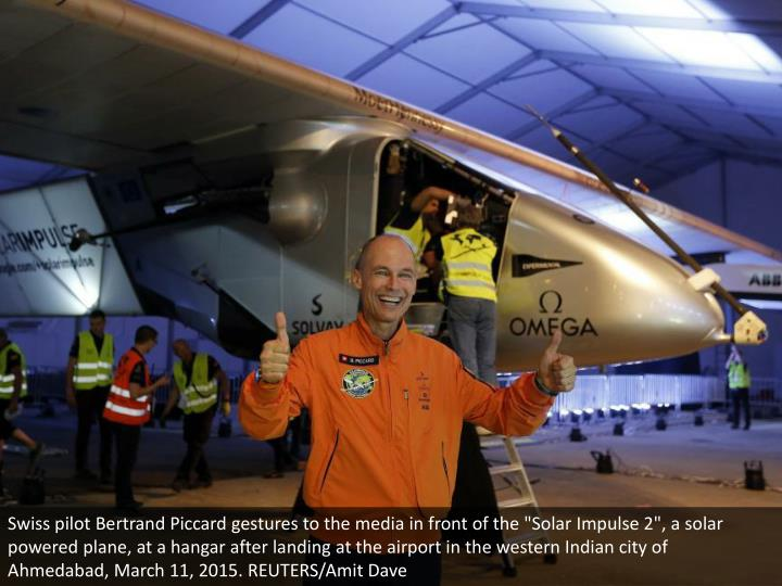 "Swiss pilot Bertrand Piccard gestures to the media in front of the ""Solar Impulse 2"", a solar powered plane, at a hangar after landing at the airport in the western Indian city of Ahmedabad, March 11, 2015. REUTERS/Amit Dave"