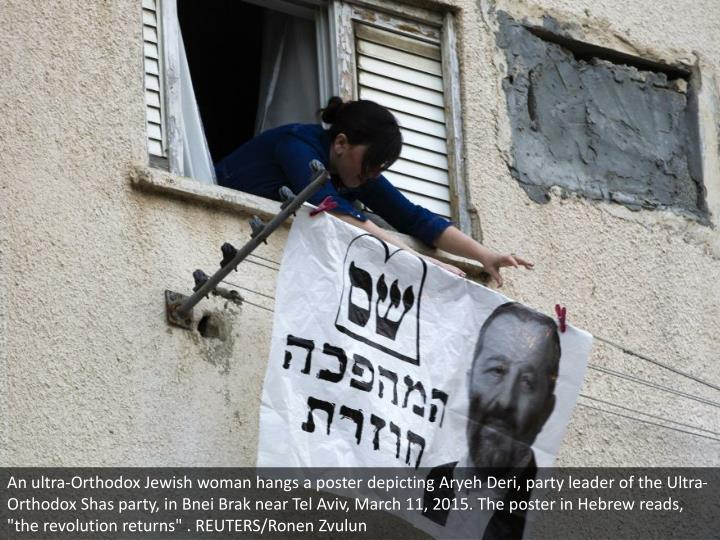 "An ultra-Orthodox Jewish woman hangs a poster depicting Aryeh Deri, party leader of the Ultra-Orthodox Shas party, in Bnei Brak near Tel Aviv, March 11, 2015. The poster in Hebrew reads, ""the revolution returns"" . REUTERS/Ronen Zvulun"