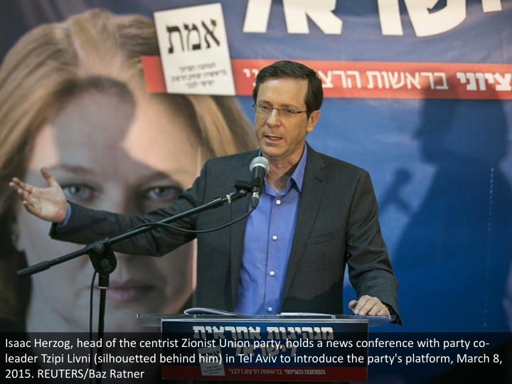 Isaac Herzog, head of the centrist Zionist Union party, holds a news conference with party co-leader Tzipi Livni (silhouetted behind him) in Tel Aviv to introduce the party's platform, March 8, 2015. REUTERS/Baz Ratner