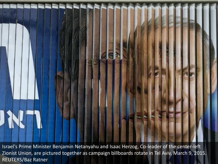 Israel's Prime Minister Benjamin Netanyahu and Isaac Herzog, Co-leader of the center-left Zionist Union, are pictured together as campaign billboards rotate in Tel Aviv, March 9, 2015. REUTERS/Baz Ratner