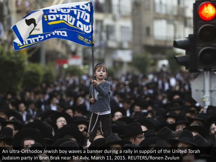 An ultra-Orthodox Jewish boy waves a banner during a rally in support of the United Torah Judaism party in Bnei Brak near Tel Aviv, March 11, 2015. REUTERS/Ronen Zvulun