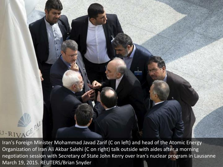 Iran's Foreign Minister Mohammad Javad Zarif (C on left) and head of the Atomic Energy Organization of Iran Ali Akbar Salehi (C on right) talk outside with aides after a morning negotiation session with Secretary of State John Kerry over Iran's nuclear program in Lausanne March 19, 2015. REUTERS/Brian Snyder