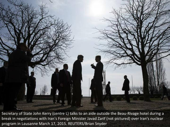 Secretary of State John Kerry (centre L) talks to an aide outside the Beau-Rivage hotel during a break in negotiations with Iran's Foreign Minister Javad Zarif (not pictured) over Iran's nuclear program in Lausanne March 17, 2015. REUTERS/Brian Snyder