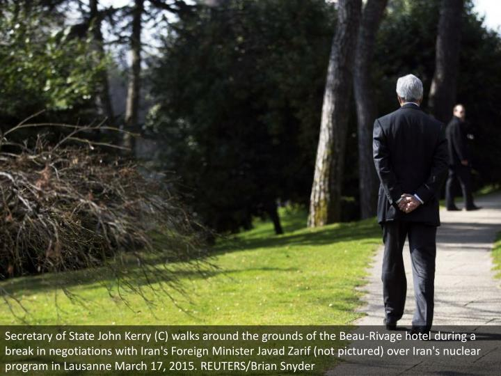Secretary of State John Kerry (C) walks around the grounds of the Beau-Rivage hotel during a break in negotiations with Iran's Foreign Minister Javad Zarif (not pictured) over Iran's nuclear program in Lausanne March 17, 2015. REUTERS/Brian Snyder