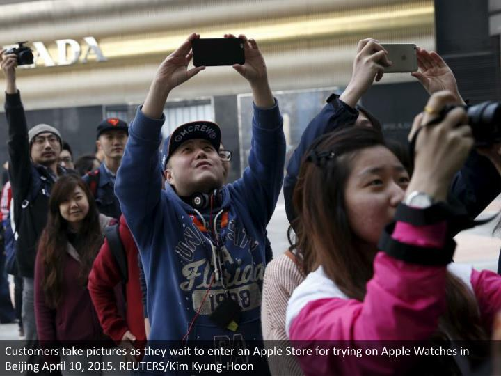 Customers take pictures as they wait to enter an Apple Store for trying on Apple Watches in Beijing April 10, 2015. REUTERS/Kim Kyung-Hoon