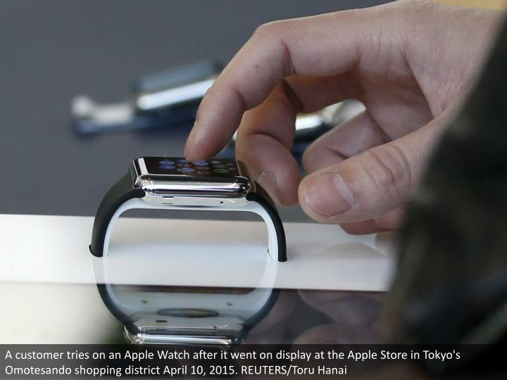 A customer tries on an Apple Watch after it went on display at the Apple Store in Tokyo's Omotesando shopping district April 10, 2015. REUTERS/Toru Hanai
