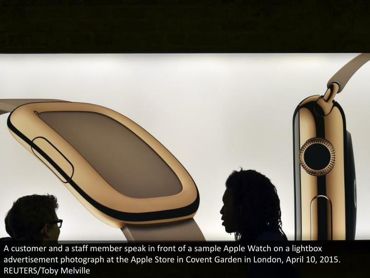 A customer and a staff member speak in front of a sample Apple Watch on a lightbox advertisement photograph at the Apple Store in Covent Garden in London, April 10, 2015. REUTERS/Toby Melville