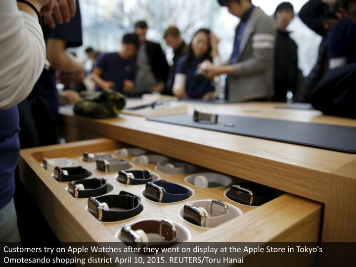 Customers try on Apple Watches after they went on display at the Apple Store in Tokyo's Omotesando shopping district April 10, 2015. REUTERS/Toru Hanai