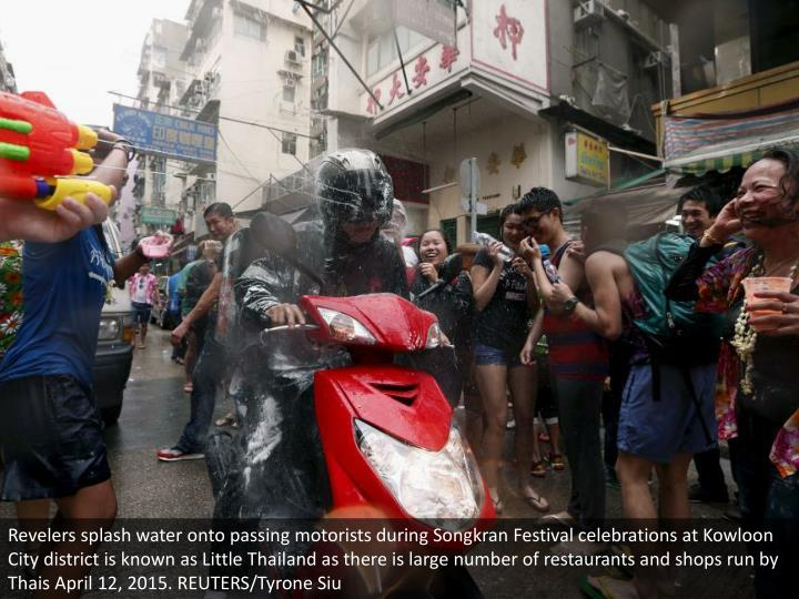 Revelers splash water onto passing motorists during Songkran Festival celebrations at Kowloon City district is known as Little Thailand as there is large number of restaurants and shops run by Thais April 12, 2015. REUTERS/Tyrone Siu