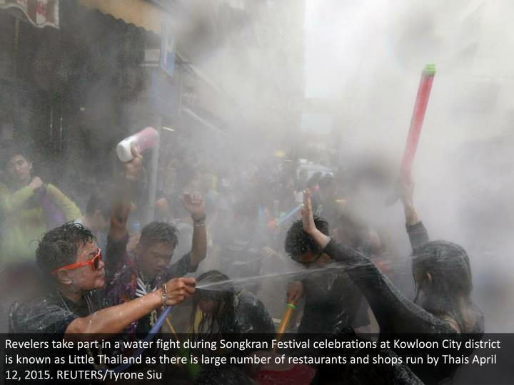 Revelers take part in a water fight during Songkran Festival celebrations at Kowloon City district is known as Little Thailand as there is large number of restaurants and shops run by Thais April 12, 2015. REUTERS/Tyrone Siu
