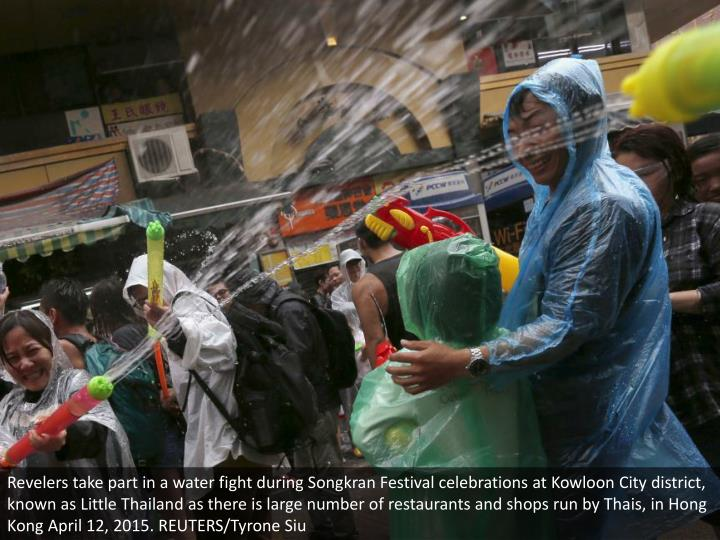 Revelers take part in a water fight during Songkran Festival celebrations at Kowloon City district, known as Little Thailand as there is large number of restaurants and shops run by Thais, in Hong Kong April 12, 2015. REUTERS/Tyrone Siu