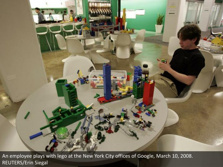 An employee plays with lego at the New York City offices of Google, March 10, 2008. REUTERS/Erin Siegal