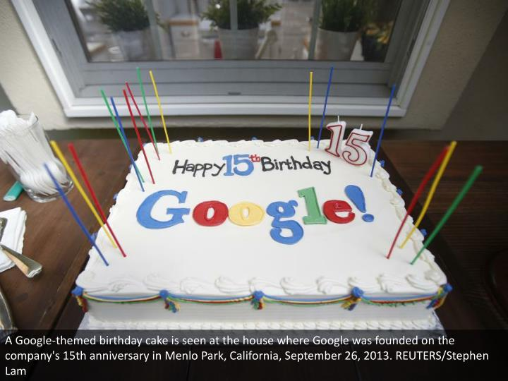A Google-themed birthday cake is seen at the house where Google was founded on the company's 15th anniversary in Menlo Park, California, September 26, 2013. REUTERS/Stephen Lam
