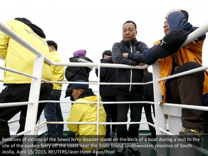 Relatives of victims of the Sewol ferry disaster stand on the deck of a boat during a visit to the site of the sunken ferry off the coast near the Jindo Island southwestern province of South Jeolla, April 15, 2015. REUTERS/Jeon Heon-Kyun/Pool