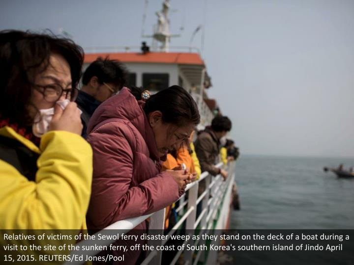 Relatives of victims of the Sewol ferry disaster weep as they stand on the deck of a boat during a visit to the site of the sunken ferry, off the coast of South Korea's southern island of Jindo April 15, 2015. REUTERS/Ed Jones/Pool