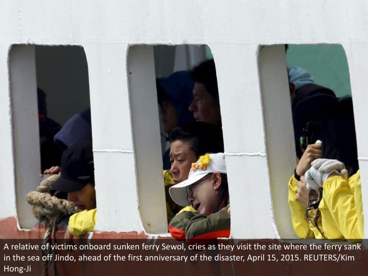 A relative of victims onboard sunken ferry Sewol, cries as they visit the site where the ferry sank in the sea off Jindo, ahead of the first anniversary of the disaster, April 15, 2015. REUTERS/Kim Hong-Ji