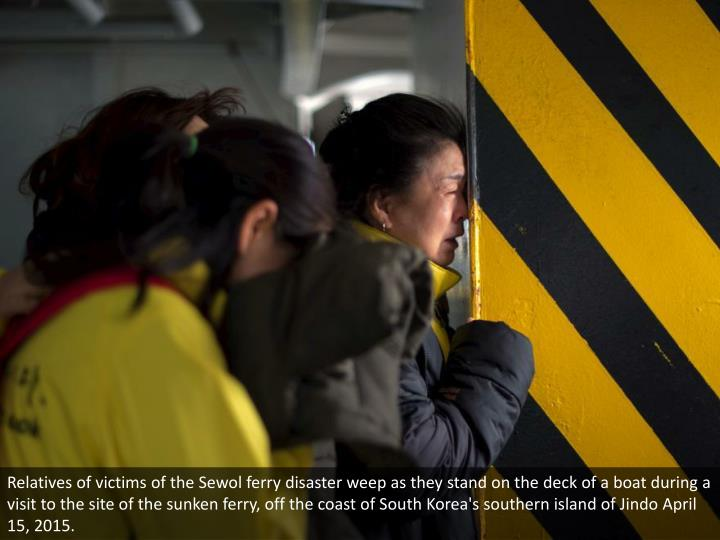 Relatives of victims of the Sewol ferry disaster weep as they stand on the deck of a boat during a visit to the site of the sunken ferry, off the coast of South Korea's southern island of Jindo April 15, 2015.