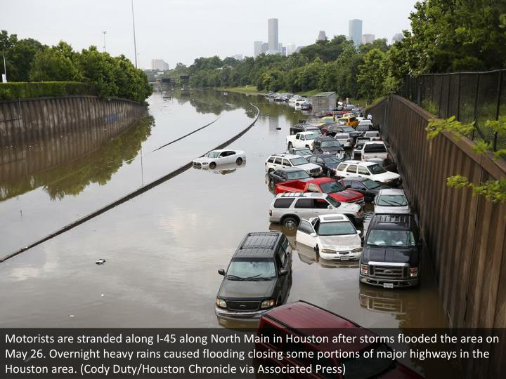 Motorists are stranded along I-45 along North Main in Houston after storms flooded the area on May 2...