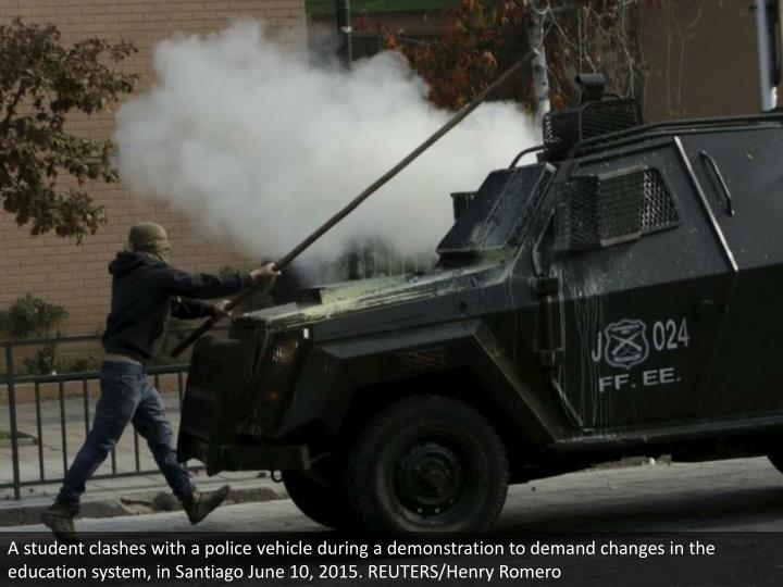 A student clashes with a police vehicle during a demonstration to demand changes in the education system, in Santiago June 10, 2015. REUTERS/Henry Romero