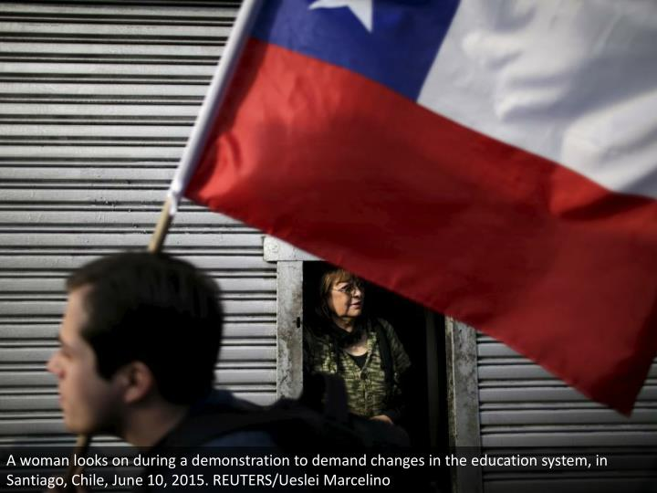 A woman looks on during a demonstration to demand changes in the education system, in Santiago, Chile, June 10, 2015. REUTERS/Ueslei Marcelino