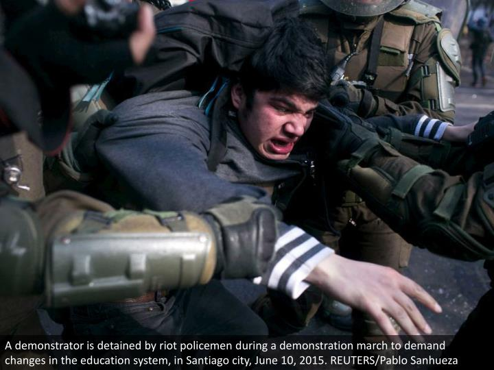 A demonstrator is detained by riot policemen during a demonstration march to demand changes in the education system, in Santiago city, June 10, 2015. REUTERS/Pablo Sanhueza