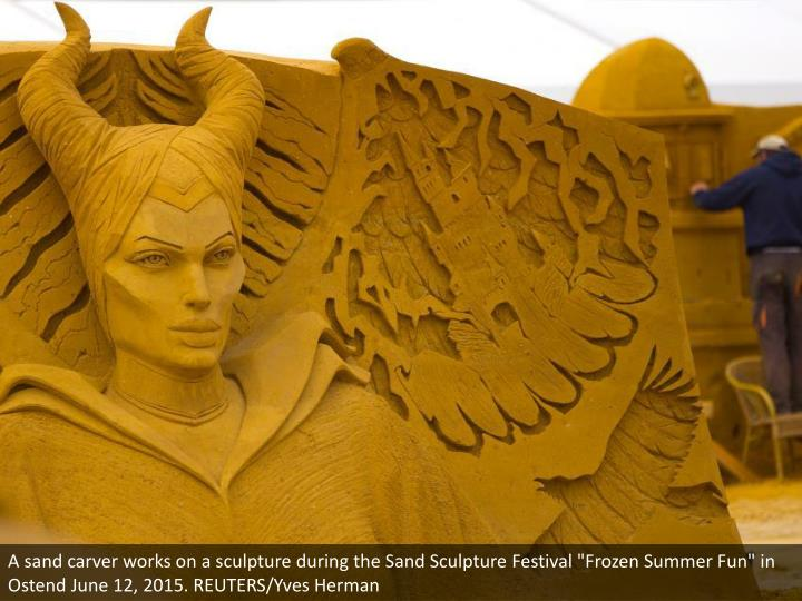 "A sand carver works on a sculpture during the Sand Sculpture Festival ""Frozen Summer Fun"" in Ostend June 12, 2015. REUTERS/Yves Herman"