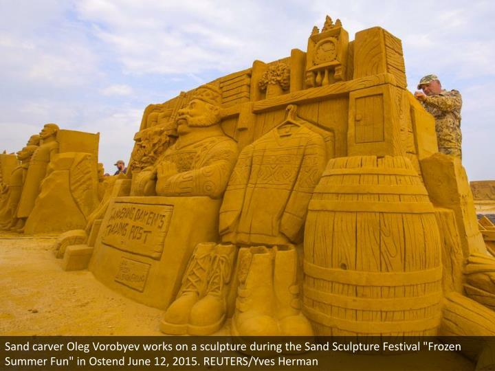 "Sand carver Oleg Vorobyev works on a sculpture during the Sand Sculpture Festival ""Frozen Summer Fun"" in Ostend June 12, 2015. REUTERS/Yves Herman"