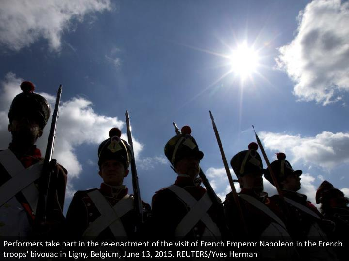 Performers take part in the re-enactment of the visit of French Emperor Napoleon in the French troops' bivouac in Ligny, Belgium, June 13, 2015. REUTERS/Yves Herman