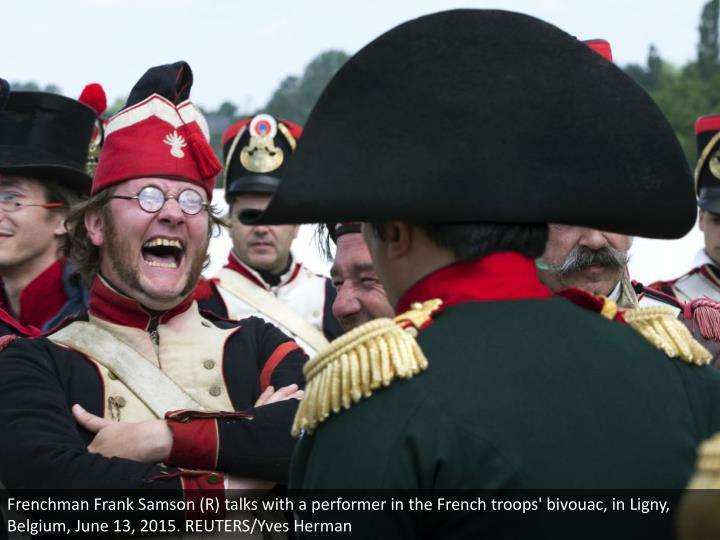 Frenchman Frank Samson (R) talks with a performer in the French troops' bivouac, in Ligny, Belgium, June 13, 2015. REUTERS/Yves Herman