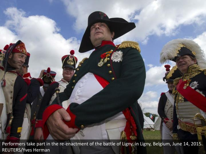 Performers take part in the re-enactment of the battle of Ligny, in Ligny, Belgium, June 14, 2015. REUTERS/Yves Herman