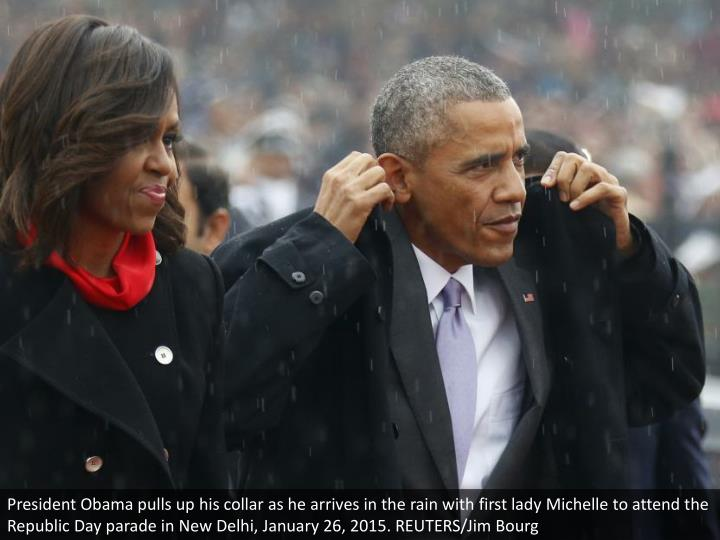 President Obama pulls up his collar as he arrives in the rain with first lady Michelle to attend the Republic Day parade in New Delhi, January 26, 2015. REUTERS/Jim Bourg
