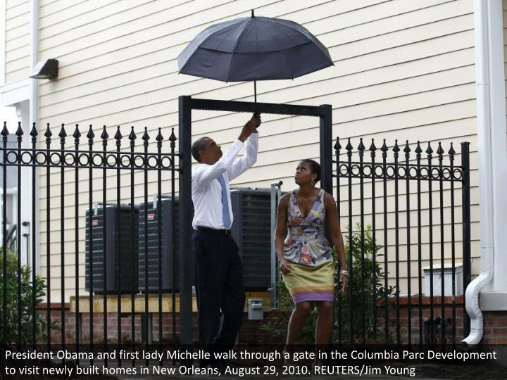 President Obama and first lady Michelle walk through a gate in the Columbia Parc Development to visit newly built homes in New Orleans, August 29, 2010. REUTERS/Jim Young