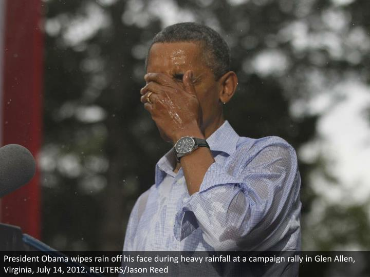 President Obama wipes rain off his face during heavy rainfall at a campaign rally in Glen Allen, Virginia, July 14, 2012. REUTERS/Jason Reed