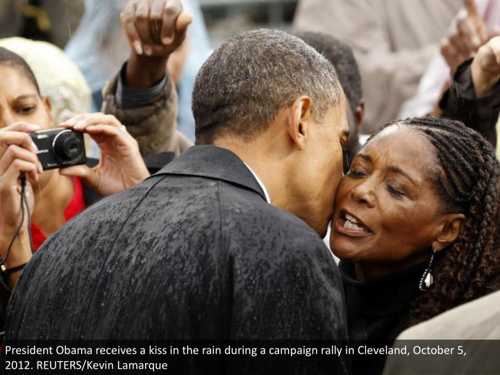 President Obama receives a kiss in the rain during a campaign rally in Cleveland, October 5, 2012. REUTERS/Kevin Lamarque