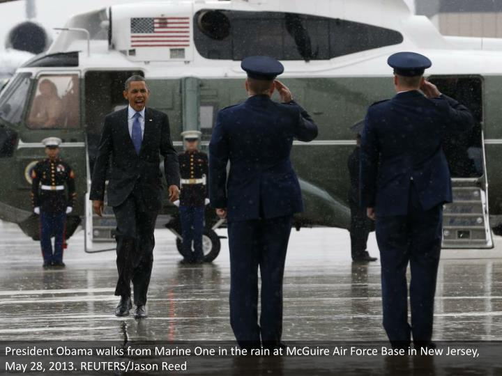 President Obama walks from Marine One in the rain at McGuire Air Force Base in New Jersey, May 28, 2013. REUTERS/Jason Reed