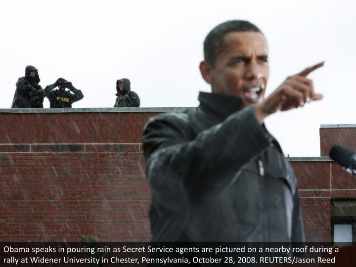 Obama speaks in pouring rain as Secret Service agents are pictured on a nearby roof during a rally at Widener University in Chester, Pennsylvania, October 28, 2008. REUTERS/Jason Reed