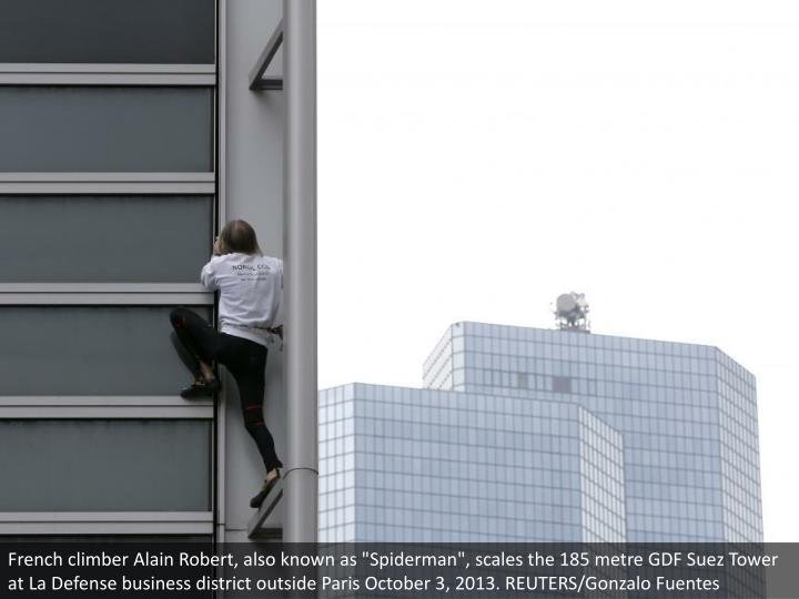 "French climber Alain Robert, also known as ""Spiderman"", scales the 185 metre GDF Suez Tower at La Defense business district outside Paris October 3, 2013. REUTERS/Gonzalo Fuentes"