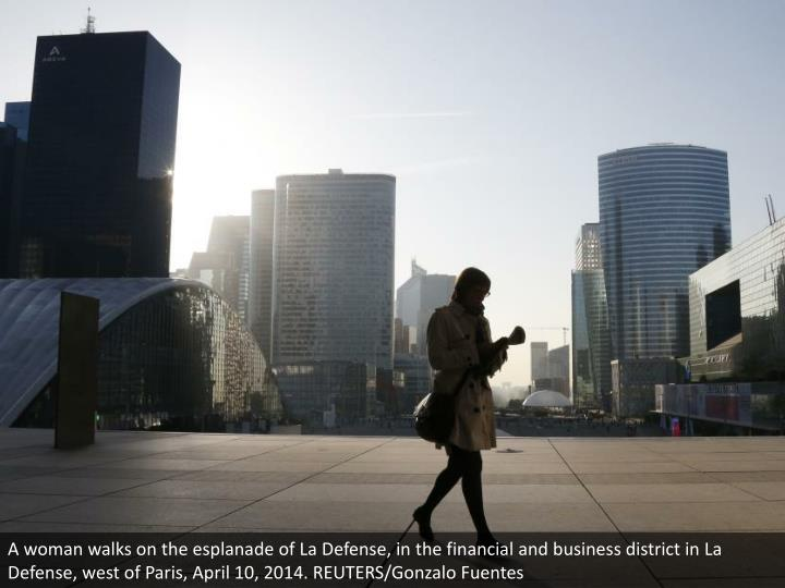A woman walks on the esplanade of La Defense, in the financial and business district in La Defense, west of Paris, April 10, 2014. REUTERS/Gonzalo Fuentes