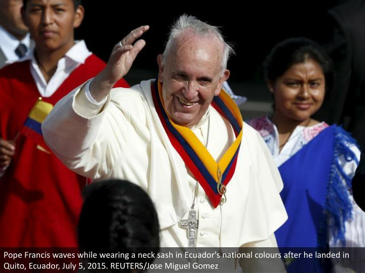 Pope Francis waves while wearing a neck sash in Ecuador's national colours after he landed in Quito, Ecuador, July 5, 2015. REUTERS/Jose Miguel Gomez